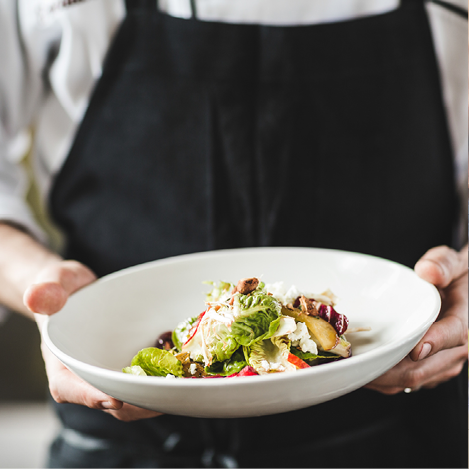 Salad on plate with wood background