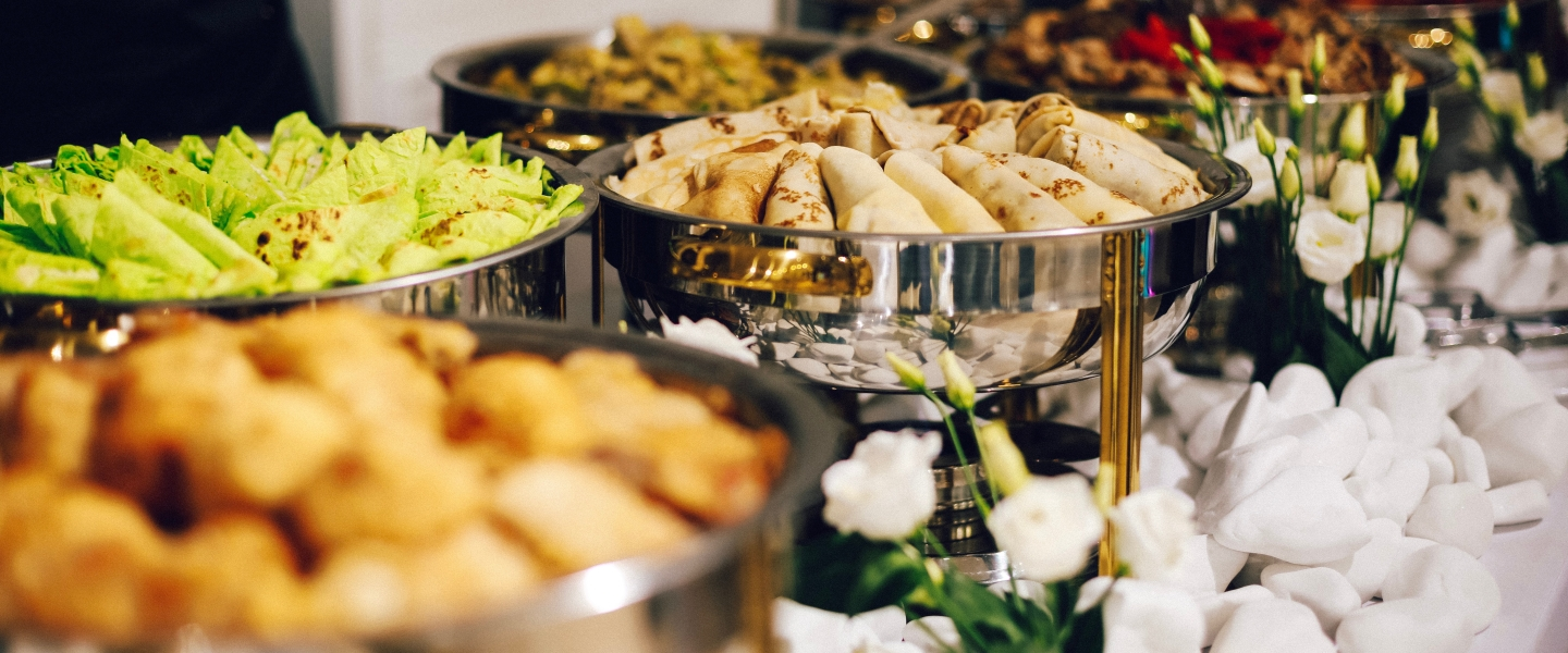 Catering setup with food in trays