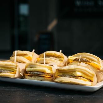 6 breakfast sandwiches on a platter from Charlie Brown's Cafe
