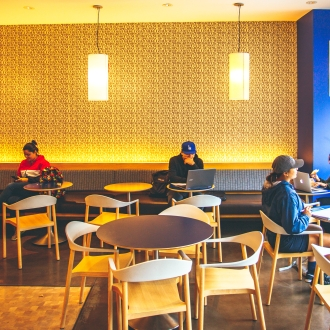 Student studying at Sip dining venue