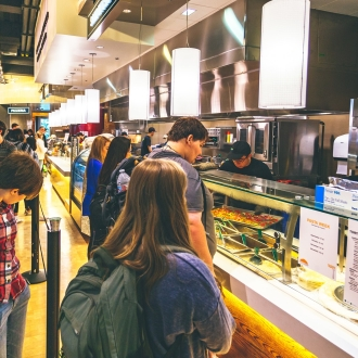 Students in line to get food at Weyden + Brewster dining venue
