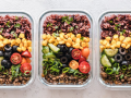 Meal in a container with corn, olives, tomatoes, ground beef