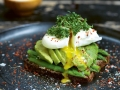 Poached egg on avocado toast on a plate