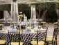 Event table setup with glassware and string lights above tables