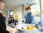Catering staff member pouring a glass of wine