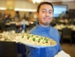 Student employee holding food plate