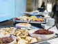 Catering setup of appetizers of bread and olive tapenade