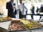 Catering tray of meats and cheese with guests in background